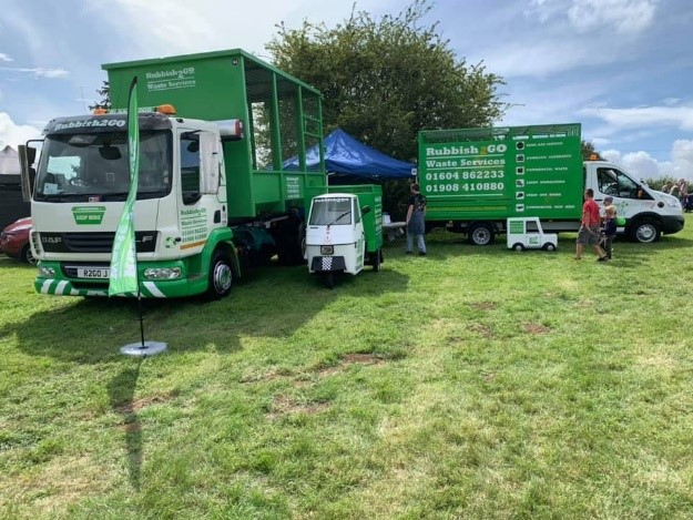 Selection of rubbish 2 go vehicles on display at festival