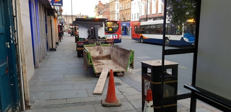 Skip being unloaded in town centre